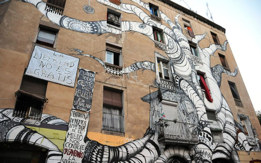 One of the few buildings in Barcelona where graffiti is on the actual building, which, in this case, qualifies as art. It is rare for graffiti to be incorporated into a building facade.