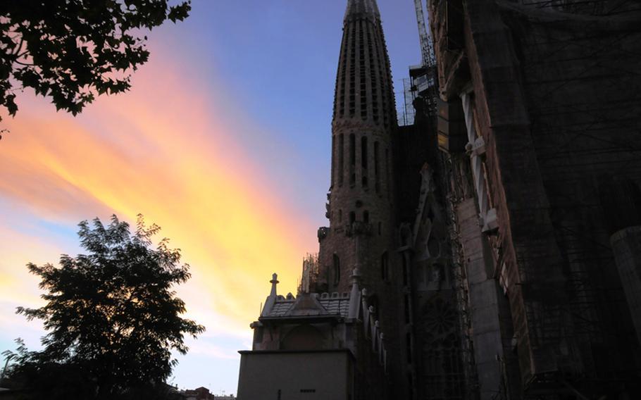 Sun sets on architect Antoni Gaudi's still unfinished La Sagrada Familia in Barcelona.