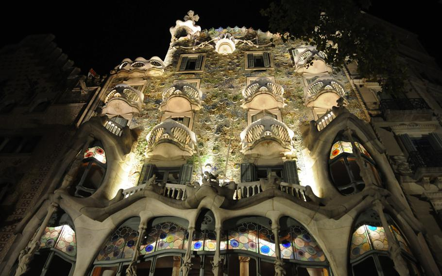 Well-placed lighting illuminate Barcelona's famed Batllo House, designed by the eccentric Spanish architect Antoni Gaudi. In 1904, building owner Josep Batllo i Casanovas commissioned Gaudi to refurbish an existing building. The home-turned-tourist attraction boasts one of the world's most impressive facades, and inside is full of curves,  from the walls to banisters, staircases and ceiling arches. The tiled roof is associated with a scaled dragon's back.