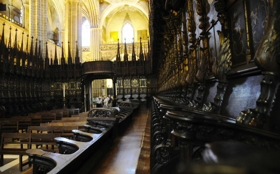Choir seats in the hushed nave of the Barecelona Cathedral.