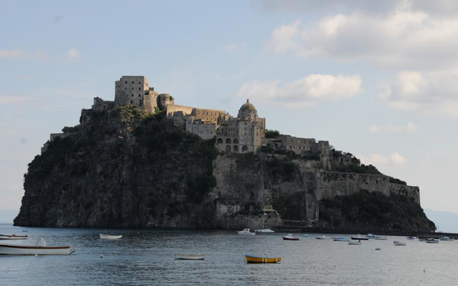 The sun breaks through the clouds to shine on  Aragonese Castle, which was built in 474 B.C. and has served as a fortress, church and now Ischia's most-visited monument.