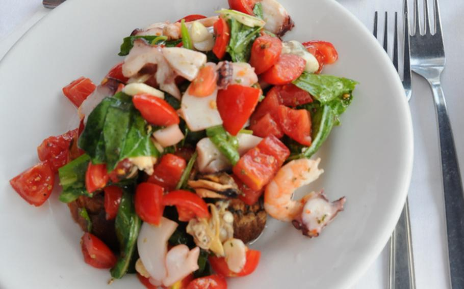 Fresh mussels, clams, tomatoes, basil and garlic top lightly toasted bread for a mouthwatering appetizer at Chalet Primavera on Ischia, known for its fresh shellfish and other seafood.