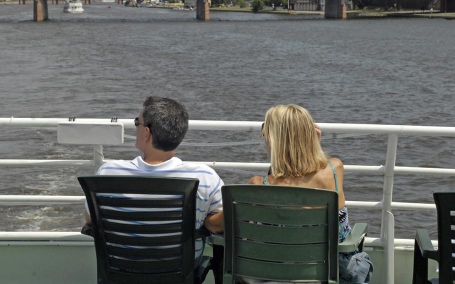A couple relaxes on the sun deck of the cruiser Nautilus as it glides on the Main River.  The Nautilus features three decks with 380 indoor seats and 200 seats on the sun deck.