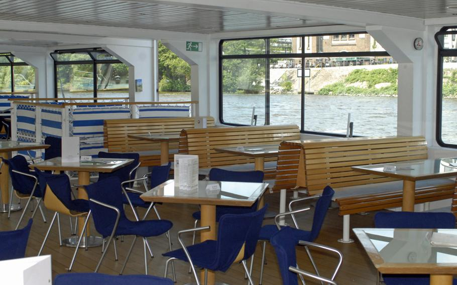 On a warm spring day, the indoor seats of the Primus-Linie cruiser Nautilus remain empty as the ship cruises the Main River in Frankfurt.