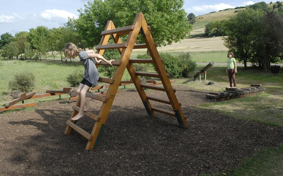 Balancing beams and various other foot stations,  such as this wooden ladder, are scattered throughout the barefoot trail.