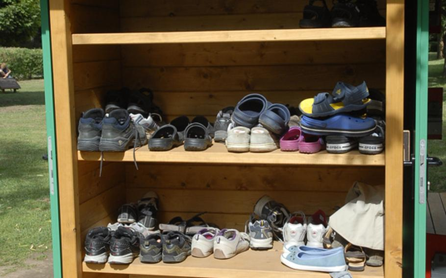 Shoeless is the way to go at the barefoot park. Visitors leave their shoes on a shelf before heading off down the park's walking trail.
