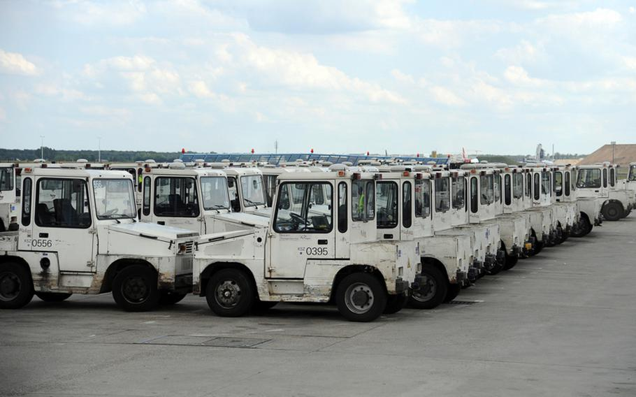 """These little vehicles known as """"Armeisen,"""" or ants, can be seen all over Frankfurt Airport's flight line, usually pulling baggage carts and containers."""