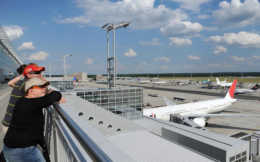 People watch the action at Frankfurt Airport from the visitors terrace. The airport is Europe's third busiest after Heathrow in London and Charles de Gaulle in Paris.