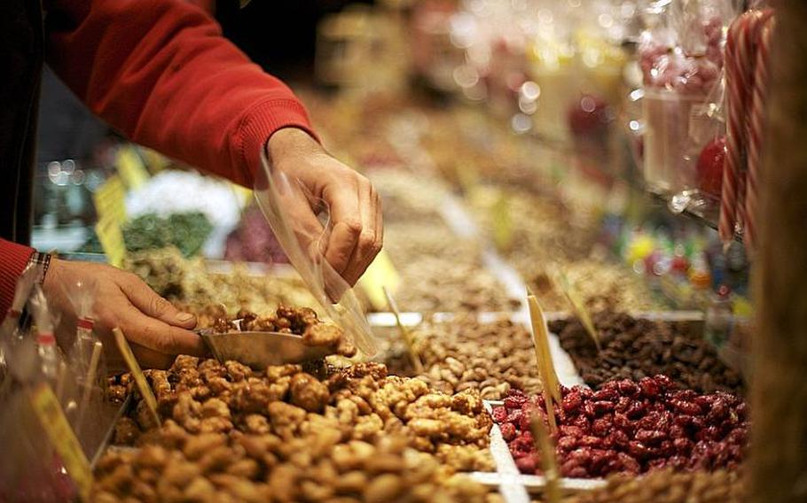Candy and candied nuts add to the aromatic landscape at the market.