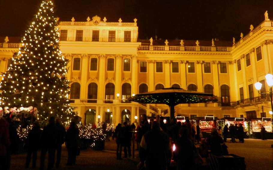 Schönbrunn palace in Vienna, Austria, provides a cultured backdrop for one of the city's Christmas markets. The market is most magical in the evening, when the palace is alight and a tall tree twinkles.