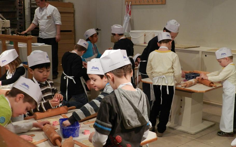 Young chefs learn how to make their own holiday treats in classes held at city hall in Vienna, Austria.