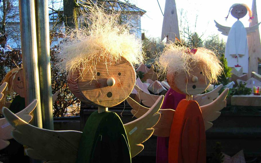 Artist Uwe Flockerzi sells handmade wooden angels such as these at the market. Vendors use products and byproducts of the surrounding forest to make their wares.