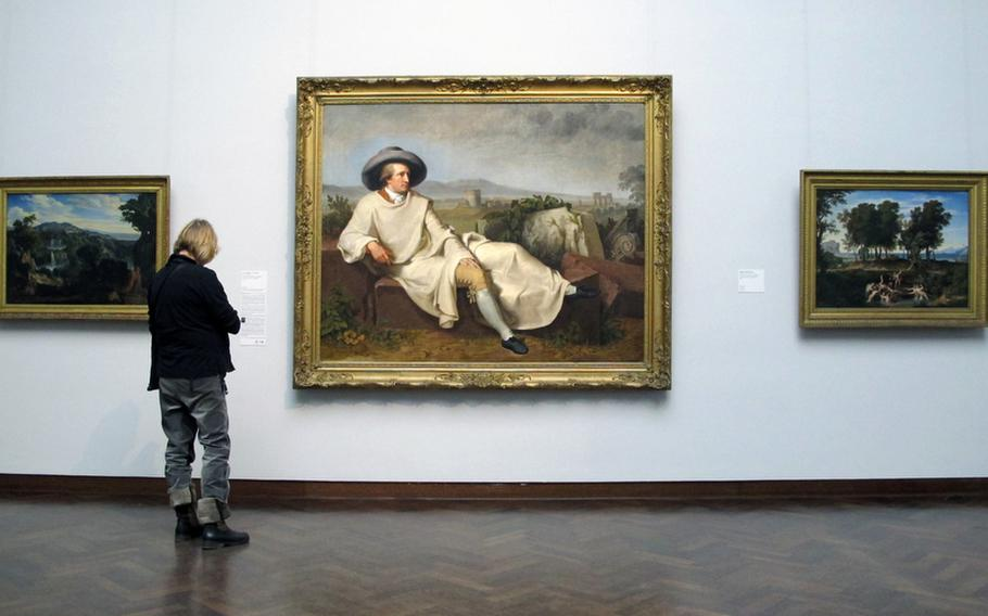 A visitor to the Städel checks out a painting of Frankfurt, Germany's local hero, Johann Wolfgang von Goethe, by Johann Heinrich Wilhelm Tischbein. It hangs at the entrance to the museum's modern art collection.