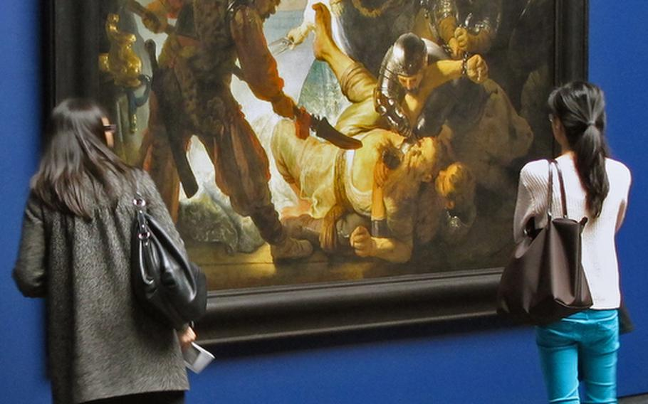 """Two visitors to the Städel art museum in Frankfurt study Rembrandt's  magnificent """"The Blinding of Samson."""""""