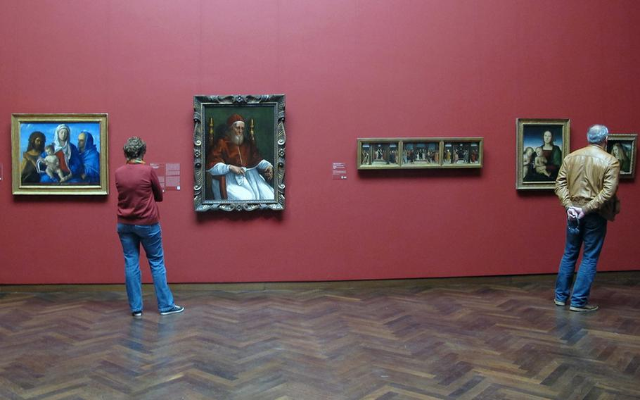 Visitors to Frankfurt.s Städel art museum check out works in the Old Masters collection. The collection highlights such artists as Botticelli, Bosch, Dürer, Rembrandt and Vermeer.