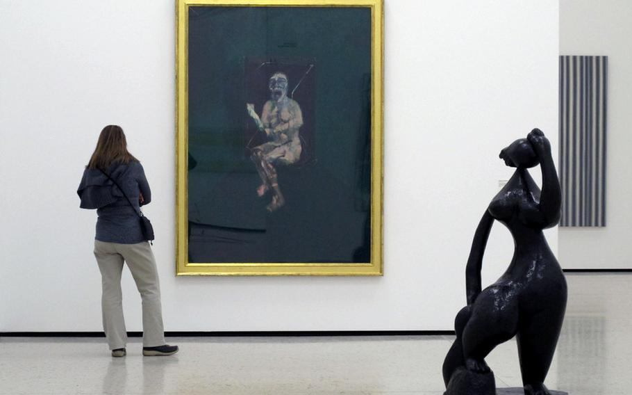 """A visitor to the Städel's contemporary art collection studies Francis Bacon's """"Battleship Potemkin."""""""