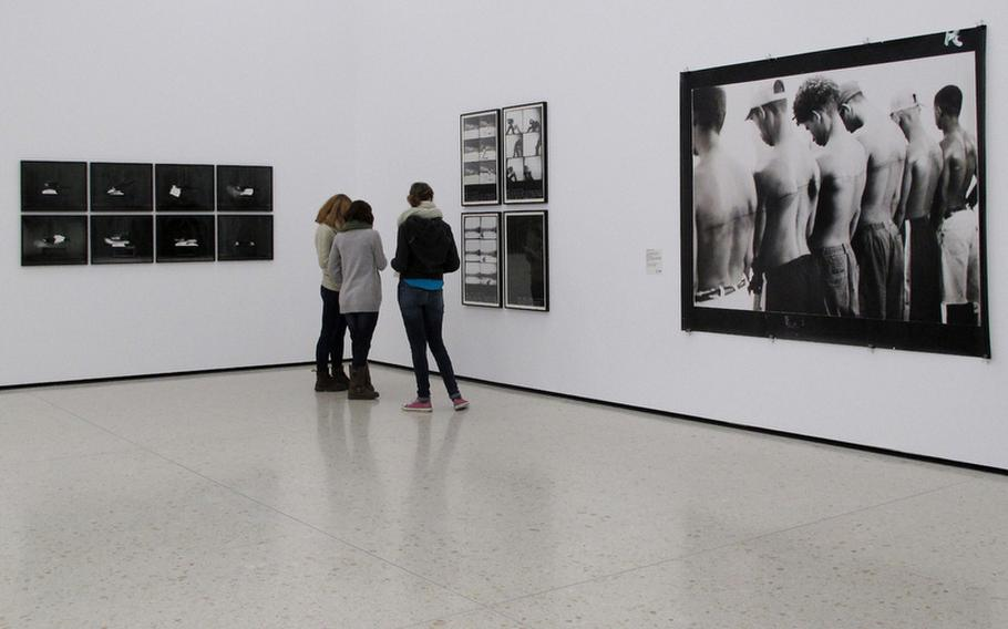 Visitors to the Städel's contemporary art collection in Frankfurt, Germany, view photographs on display.