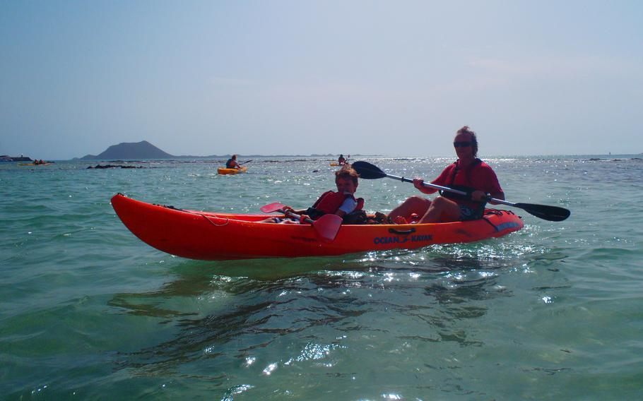 Author Joe Cawley and son, Sam, head out for a kayak-and-snorkeling safari with other adventurers on the island of Fuerteventura in the Canary Islands.