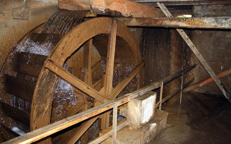 The old mill wheel still churns at Eselsmuehle, which is one of six active mini-mills operating around Echterdingen-Leidenfeld, Germany.