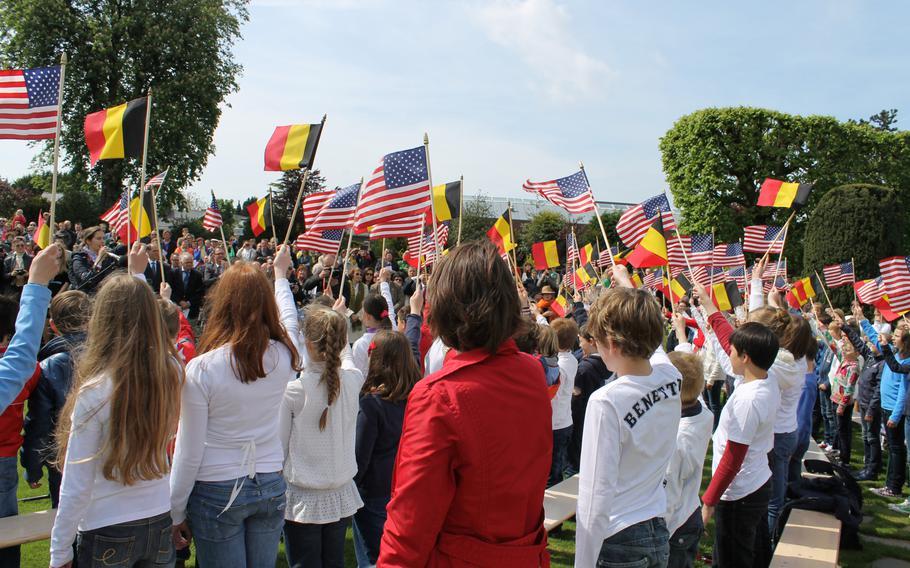 "Schoolchildren from Waregem, Belgium, sing ""The Star-Spangled Banner"" at the Flanders Field American Cemetery."