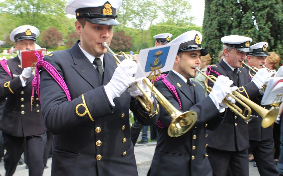 The Royal Band of the Belgian navy leaves the Flanders Field American Cemetery in in Waregem, Belgium, with a final song after the Memorial Day service.