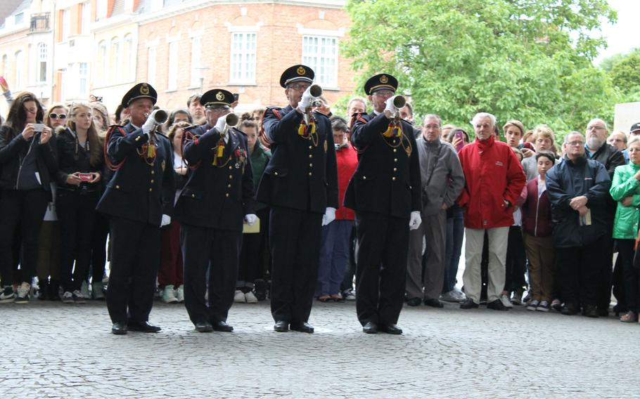 In Ypres, Belgium, buglers play a traditional final salute to fallen soldiers during the Last Post ceremony under the  Menin Gate Memorial, which honors British and Commonwealth troops who were killed in the Ypres area but have no known graves. The service, first held in 1928,is conducted every evening to honor all who fought in or near Ypres during World War I.