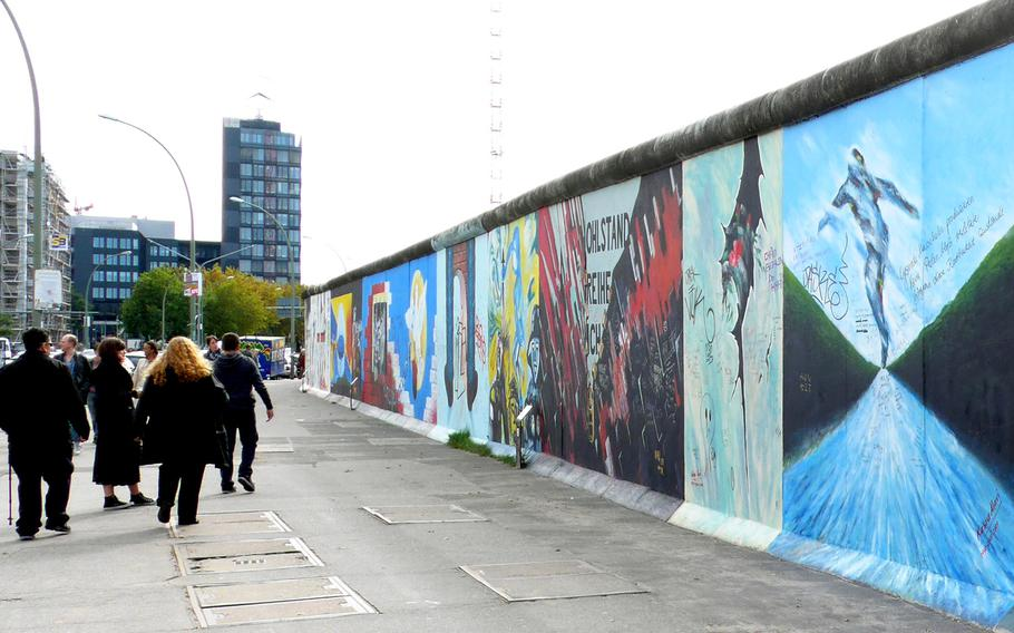 The East Side Galley,  at nearly a mile long, is the longest piece of the Berlin Wall still standing. During the Cold War, this side of the wall would have been in East Berlin and would have been blank.