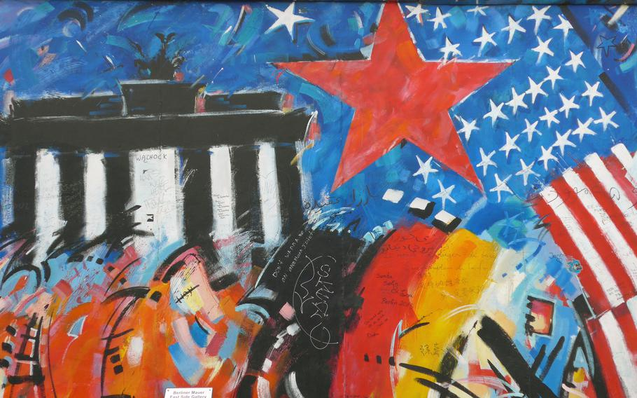 A work by Peter Lorenz on Berlin's East Side Gallery depicts the Brandenburg Gate, the American flag and the Soviet red star. The remnant of the Berlin Wall is considered the world's largest open-air gallery.