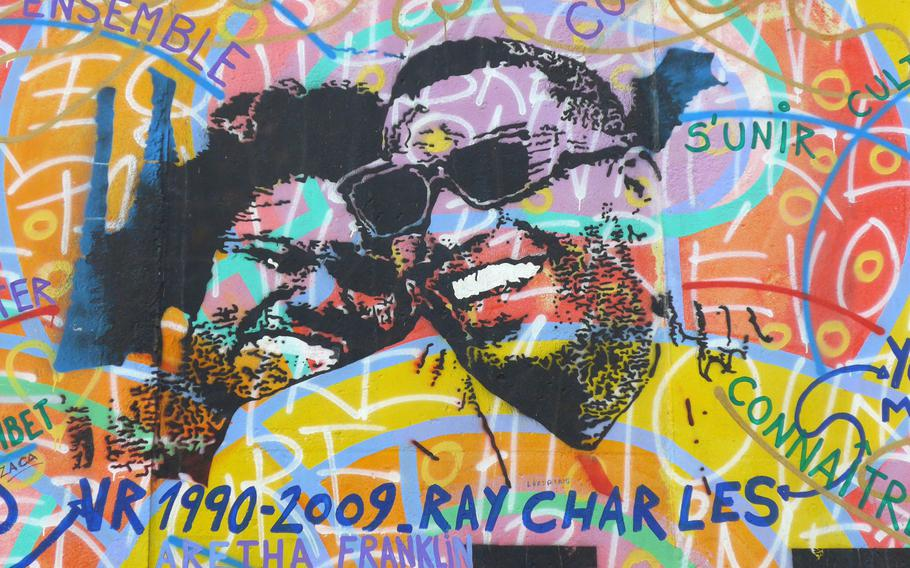 Not all of the artwork on the gallery is political — some is just colorful. Here, American music legends Ray Charles and Aretha Franklin are depicted.