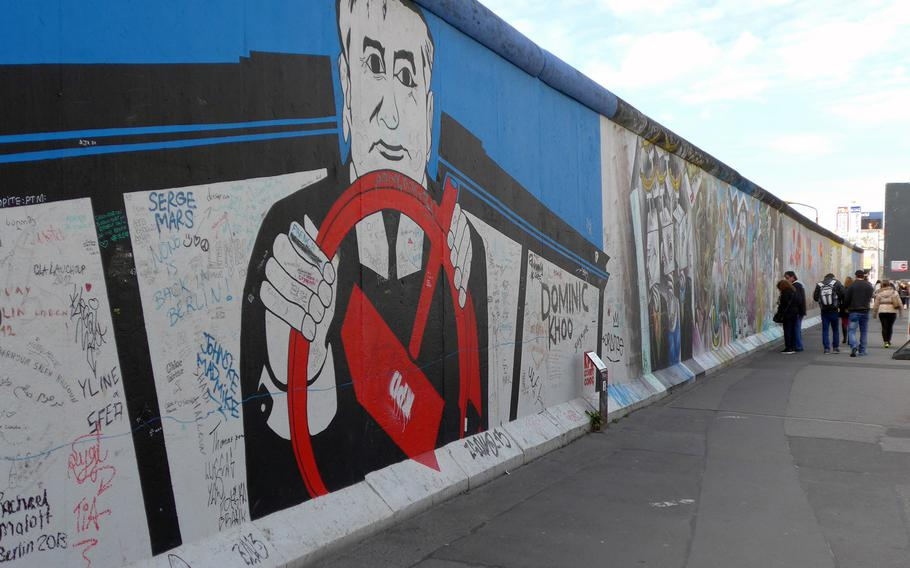 A mural by Georg Lutz depicts former Soviet leader Mikhail Gorbachev driving. Although Ronald Reagan famously called for him to tear down the wall, some give Gorbachev partial credit for its peaceful destruction because he did not send in Warsaw Pact troops to stop it.