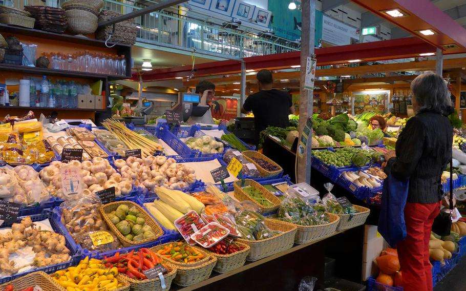 Fresh produce fill baskets at the Kleinmarkthalle in Frankfurt, Germany.