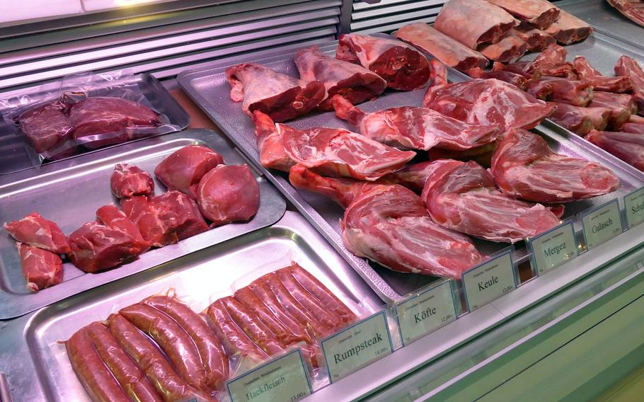 A butcher's stand showcases various types of beef and lamb at the Kleinmarkthalle in Frankfurt, Germany.