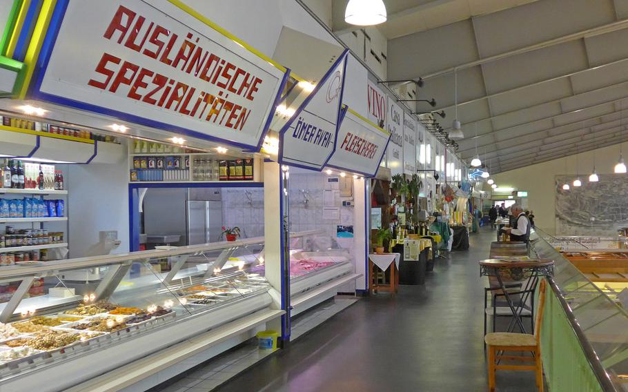 The inside balcony of the Kleinmarkthalle in Frankfurt, Germany, is lined with stands offering Middle Eastern specialties, premium olive oil, wine, seafood and poultry.