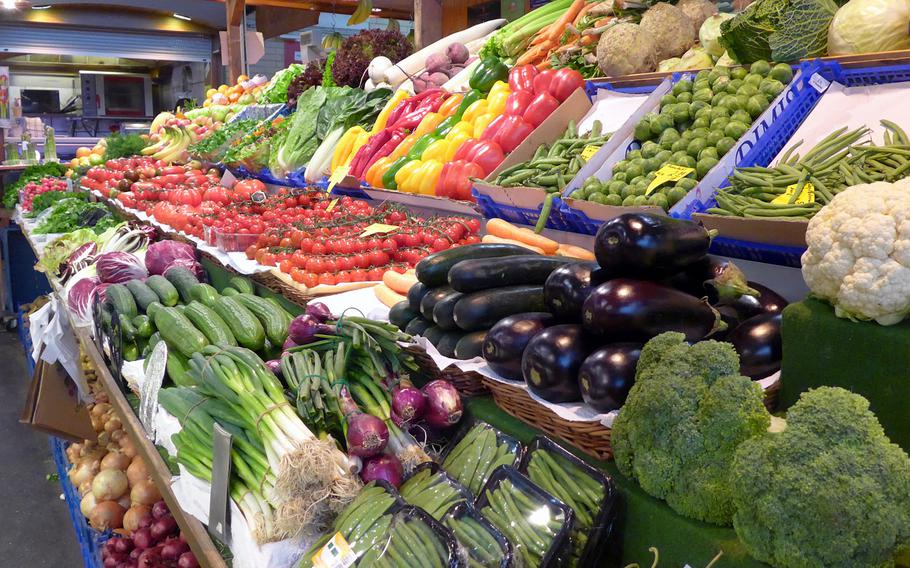 Fresh produce is neatly displayed at a stand at the Kleinmarkthalle in Frankfurt, Germany.