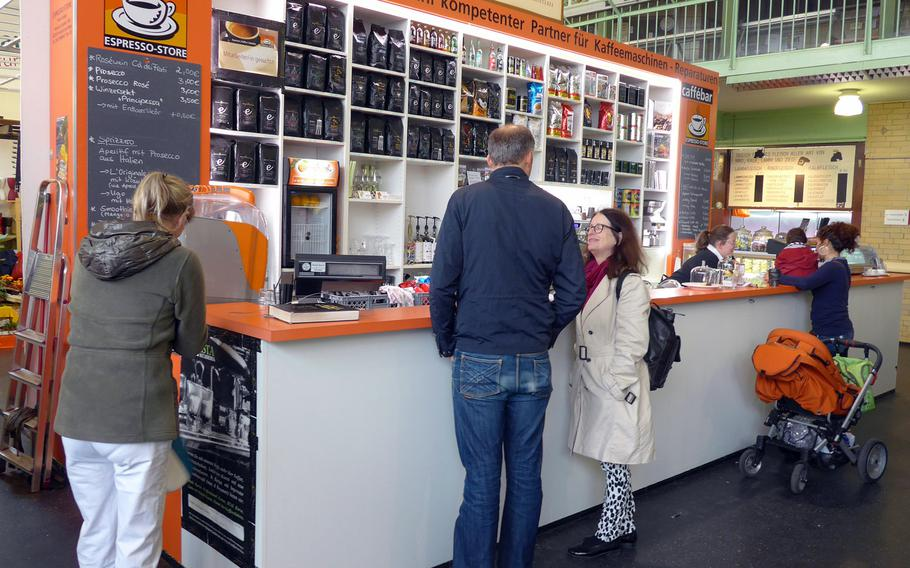 Coffee lovers take advantage of a stand at the Kleinmarkthalle in Frankfurt, Germany, that specializes in espresso beans.