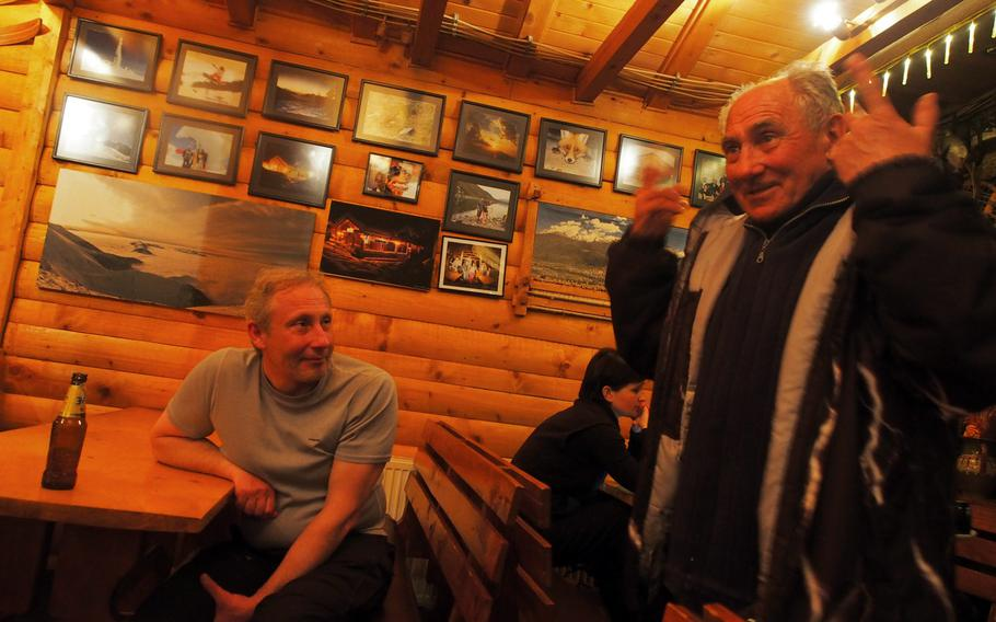 A longtime resident of Brezovica, Kosovo, spins a yarn at one of the bars that remained open even though the ski lifts have been closed for a year.