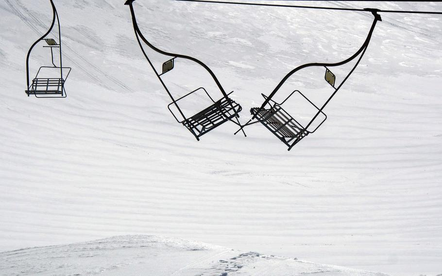 Long-dormant lifts lashed together by wind high on the slopes of Brezovica, Kosovo. The lifts haven't turned for a year due to some combination of non-payment of bills and ethnic dispute.