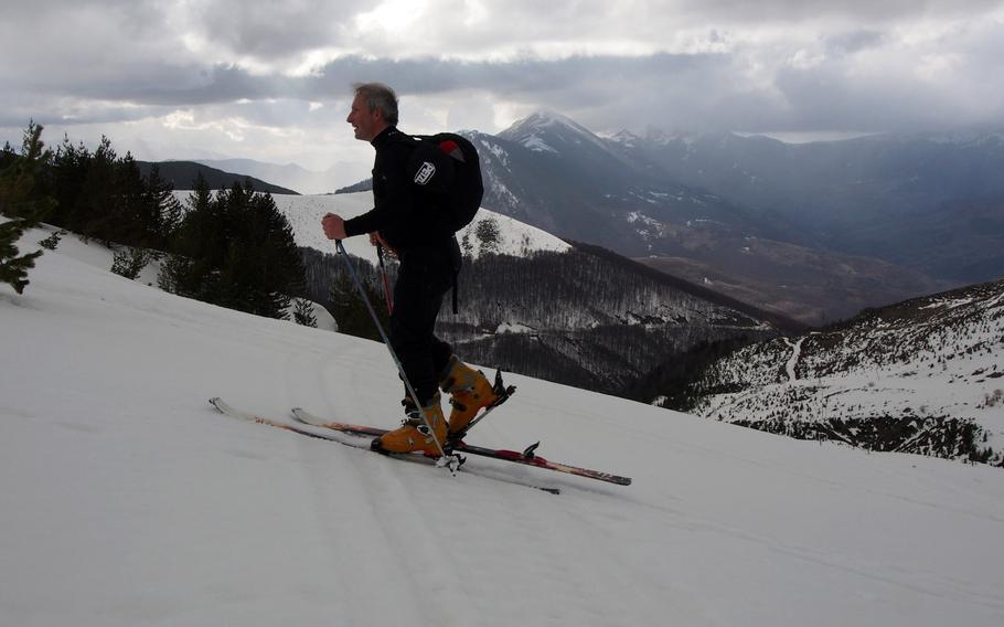 Fred Colin, a skier from France, skins up the mountain at Brezovica, Kosovo, a large ski resort that has fallen on hard times. The lifts haven't turned for a year, but that means ski enthusiasts can have the place to themselves.