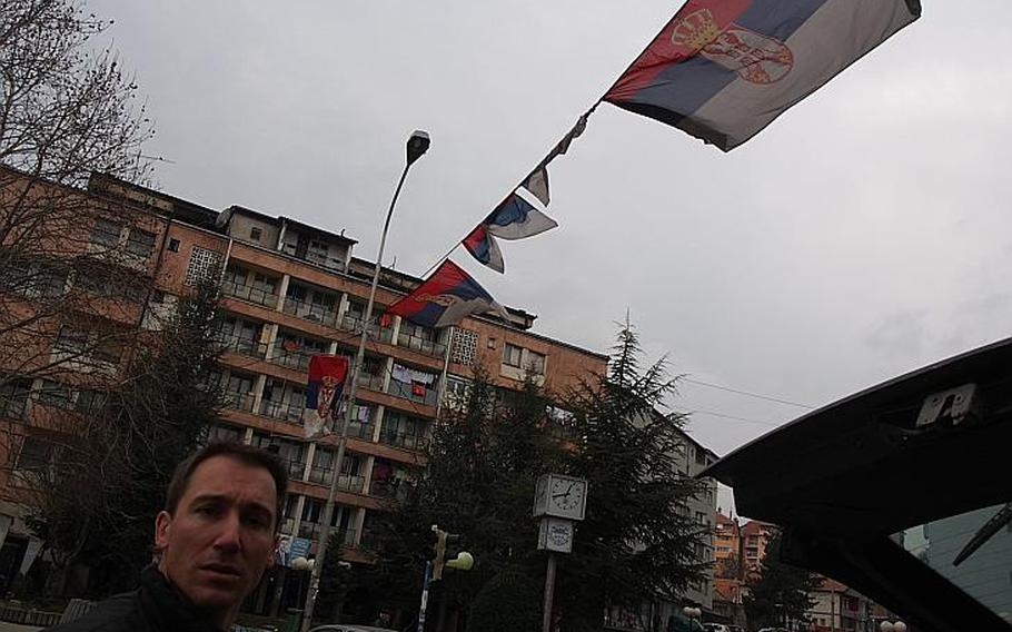 Serbian flags fly in the ethnically Serbian side of Mitrovice, Kosovo. The residents on that side of the bridge claim they should still be part of Serbia, while Kosovo claims the territory.