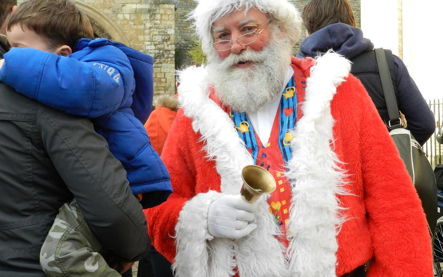 A Santa look-alike mingled with the crowds at the Lincoln, England, Christmas market in 2012, to the delight of children and adults alike.