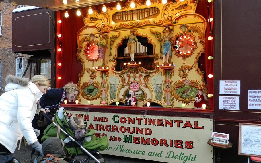 A colorful calliope added to the festive mood at the Christmas market in Lincoln, England.