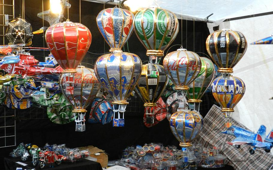 Colorful tree ornaments made out of recycled aluminum cans were among the decorations sold at the Christmas market in Lincoln, England, in 2012.
