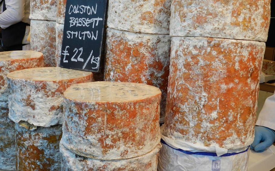 Mounds of cheese tempt visitors to the Lincoln, England, Christmas market.