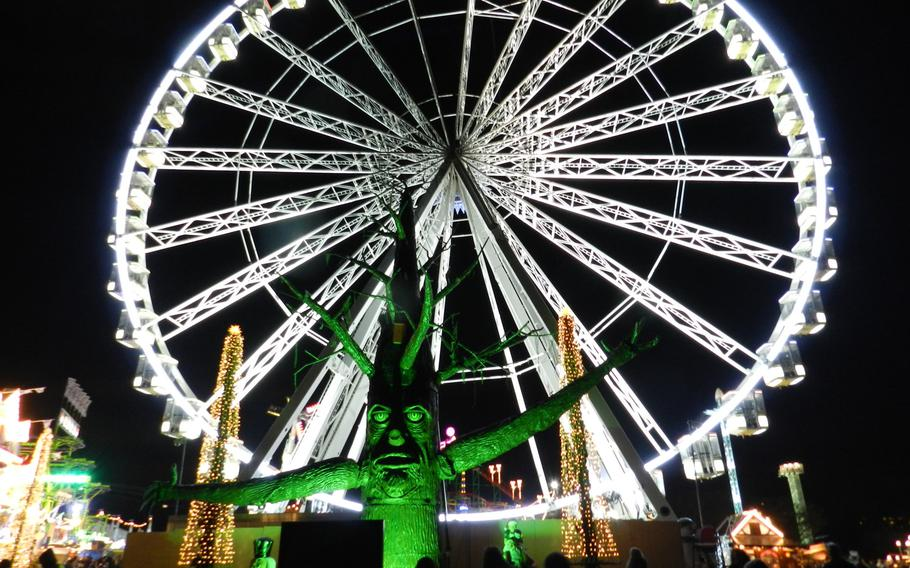 A giant Ferris wheel provides the background to an animated tree trunk that told jokes to passers-by at the 2012 Winter Wonderland Hyde Park in London.