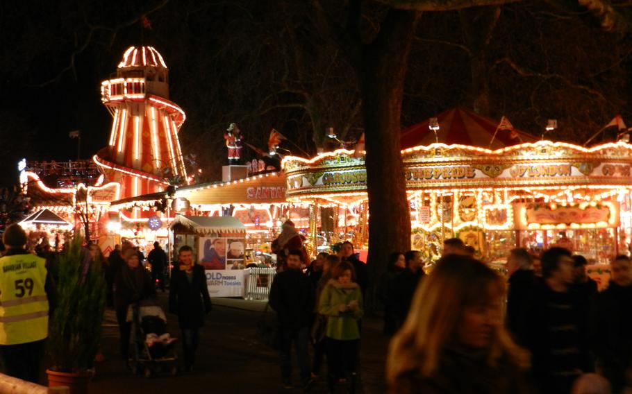 Rides galore light up the midway at London's 2012 Winter Wonderland Hyde Park.