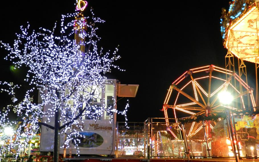 Sparkling tree lights compete with midway lights for the prettiest show at the Winter Wonderland Hyde Park in London.