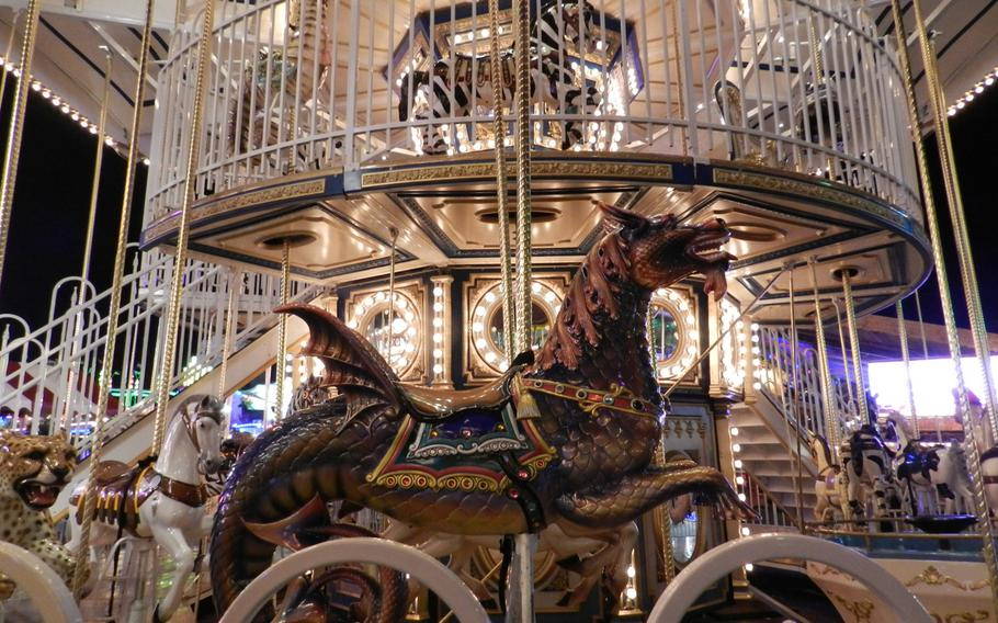 A fanciful double-decker carousel offered rides on a dragon and leopard as well as the usual merry-go-round horses at London's 2012 Winter Wonderland Hyde Park.