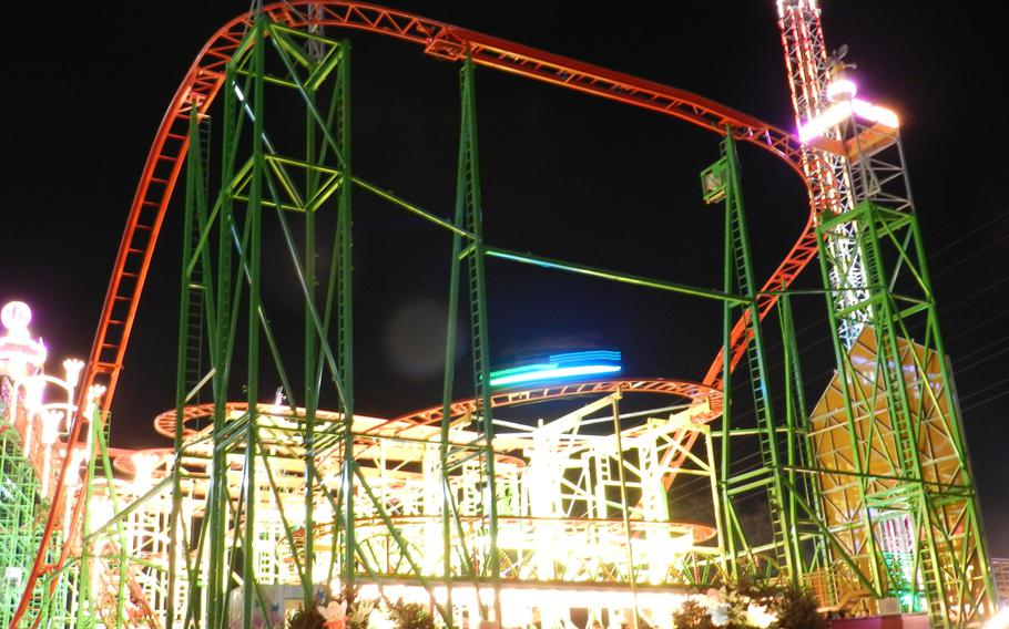 A roller coaster helps light up the midway at London's 2012 Winter Wonderland Hyde Park.