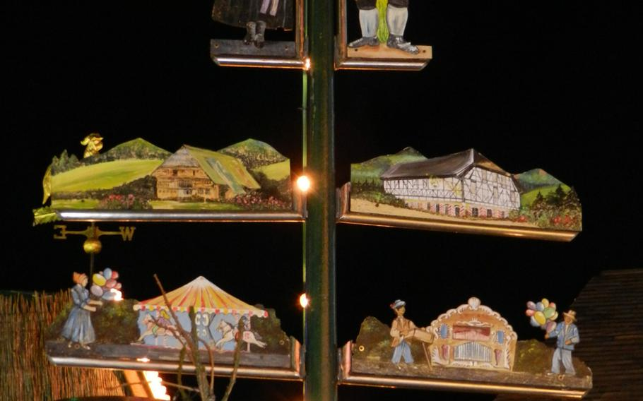 Typical German scenes are posted on a pole at the Bavarian Village section of London's Winter Wonderland Hyde Park.