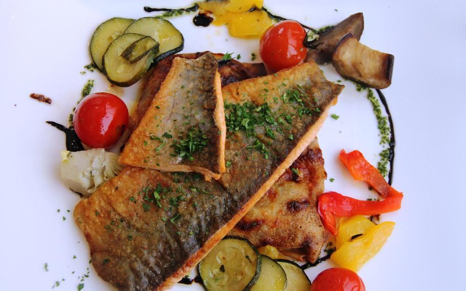 Think of cheese and chocolate when you think of Swiss foods? Think again; fish is a popular Swiss food. Pictured is saibling (brook trout) with a ratatouille crepe.